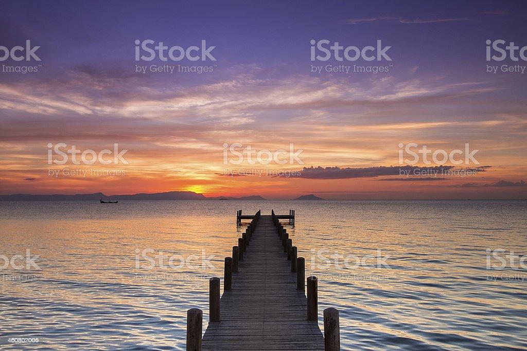 Sunset on a pontoon facing the sea stock photo