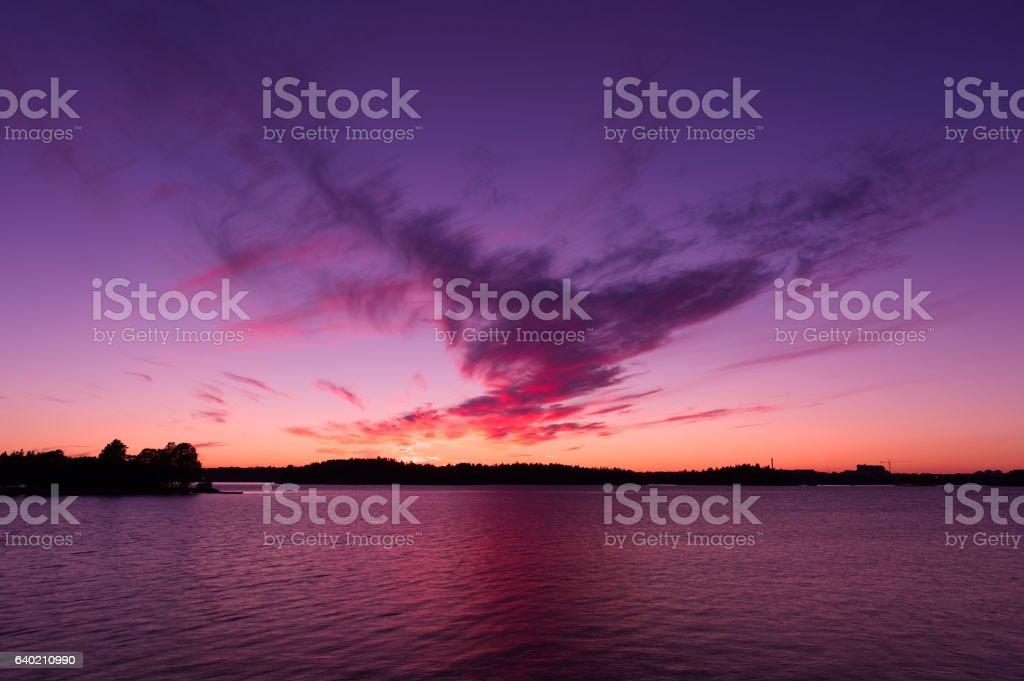 Sunset on a seascape, purple sky and cloud stock photo