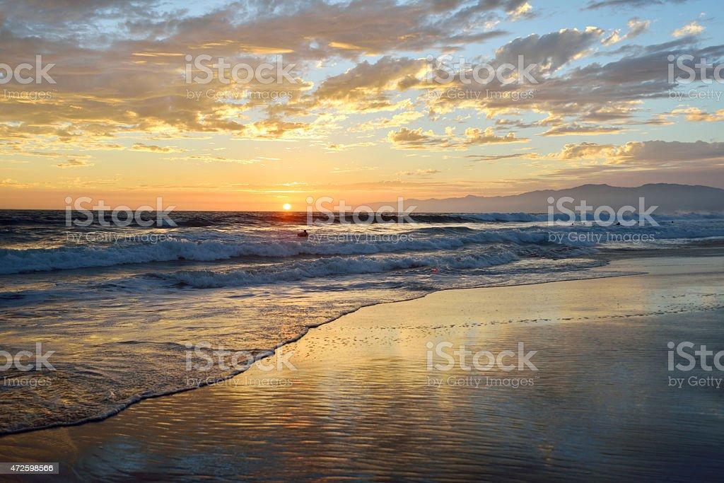 A sunset on a Venice beach landscape stock photo