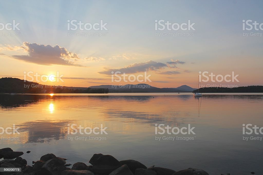 Sunset on a Vermont lake stock photo