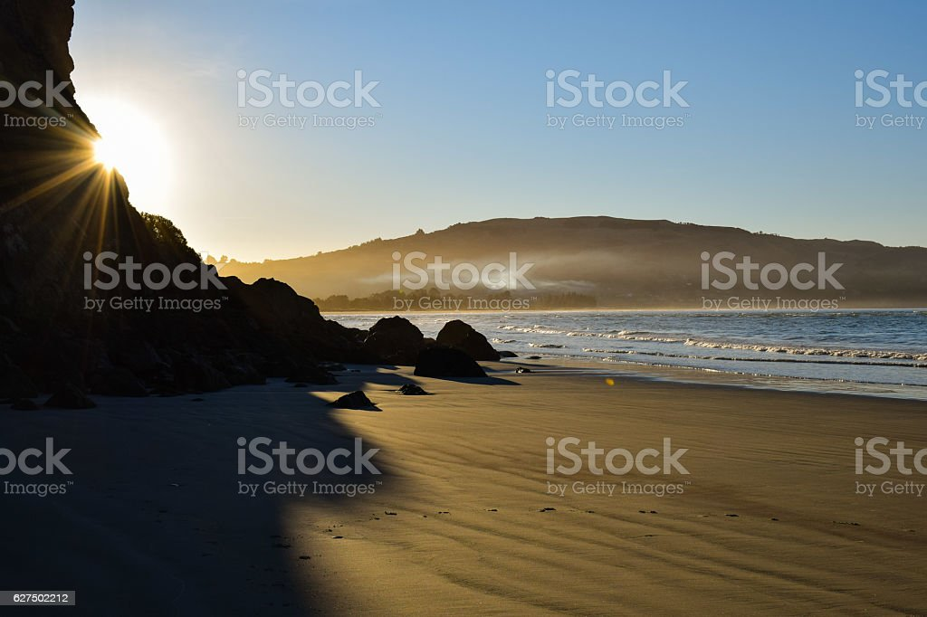 Sunset on an empty beach in New Zealand royalty-free stock photo