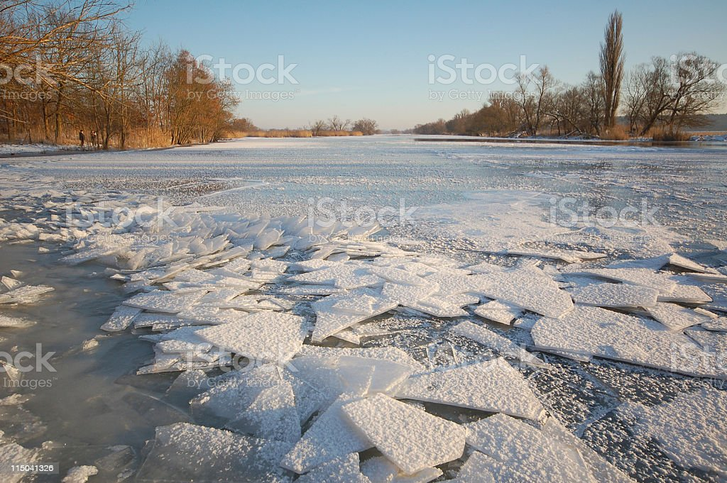 sunset on at river with ice floe winter landscape stock photo