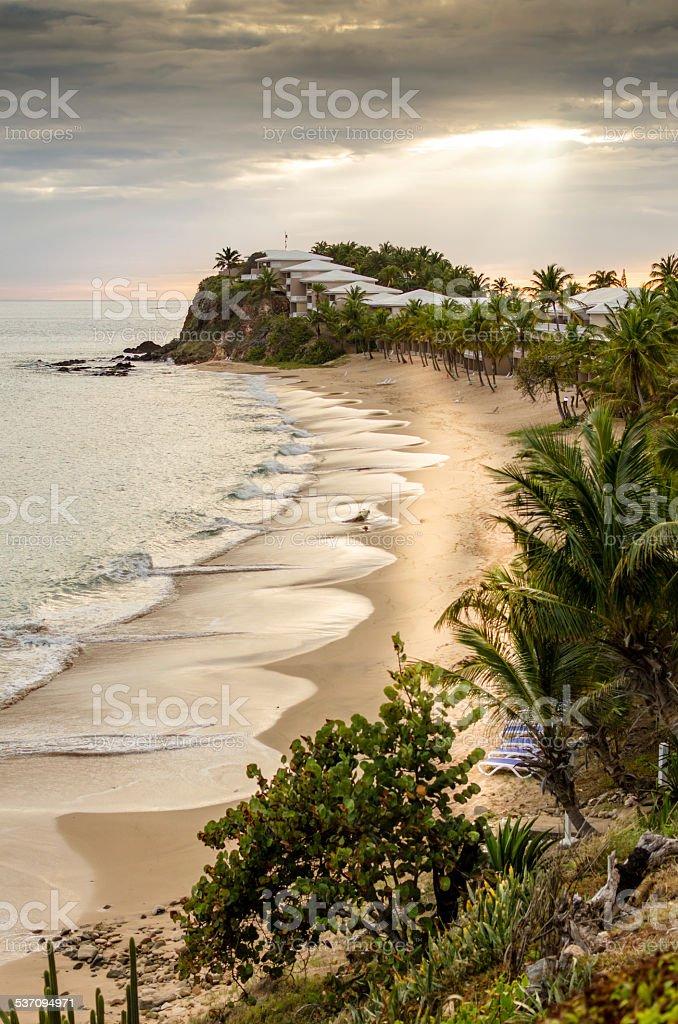Sunset on beach peninsular in Antigua stock photo
