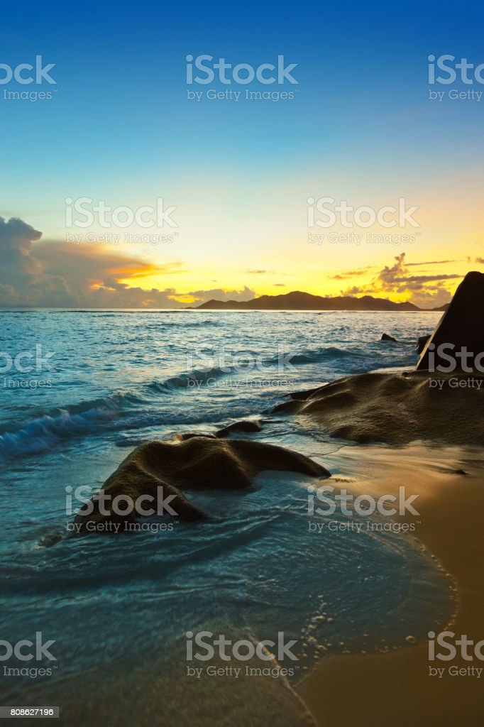 Sunset on beach Source D'Argent at Seychelles stock photo