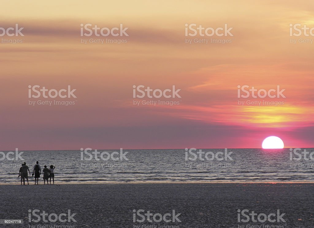 Sunset on beach with pink sky stock photo