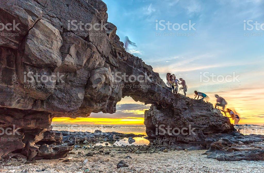Sunset on giant stone gate stock photo
