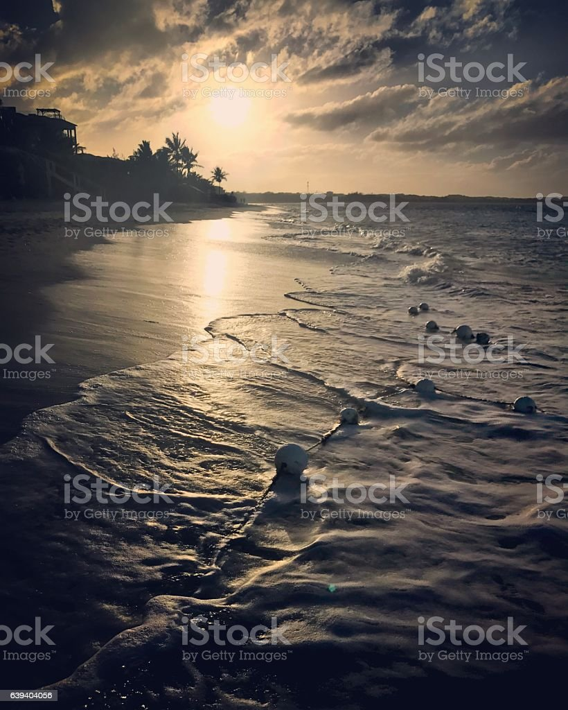 Sunset on Grace Bay Beach, Turks and Caicos Islands. stock photo