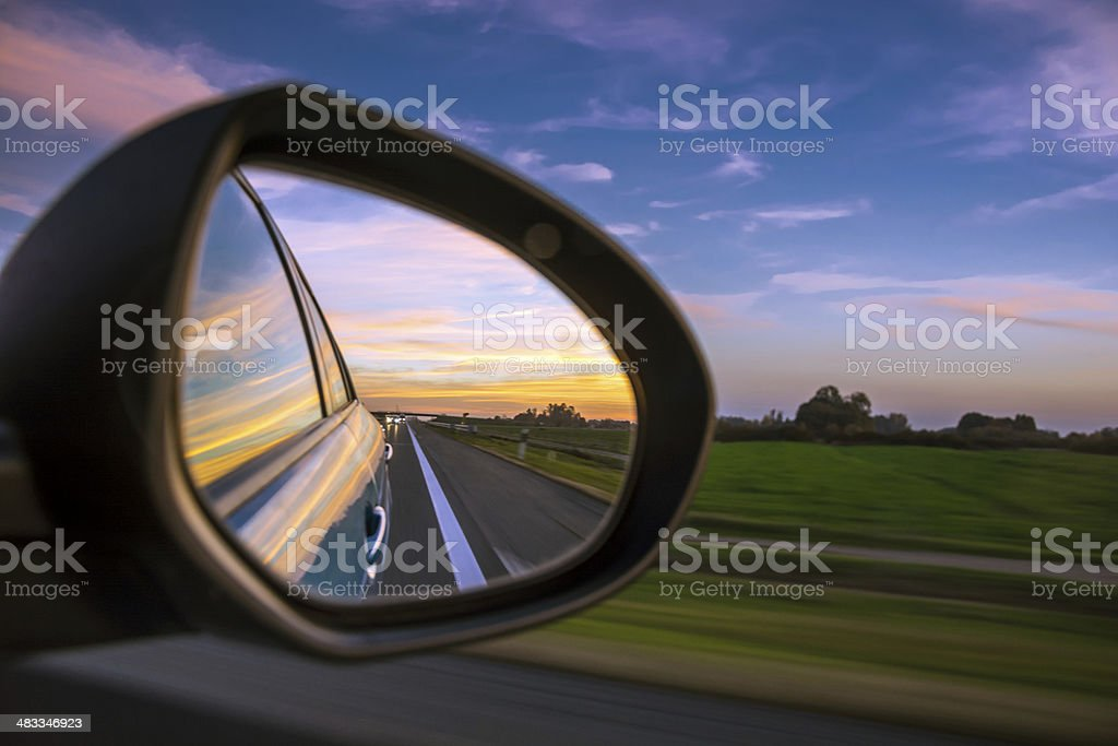 Sunset on highway (motin blured) stock photo