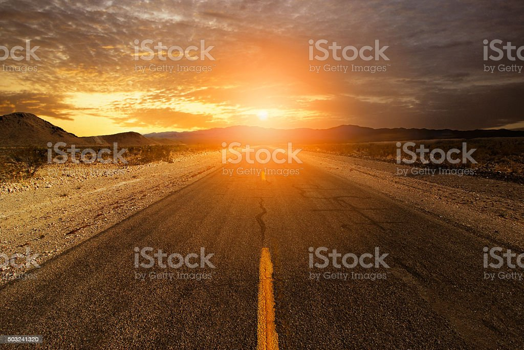 Sunset on Horizon of Desert Road stock photo
