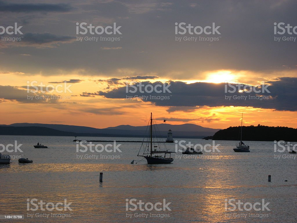Sunset on Lake Champlain Vermont with Boats stock photo