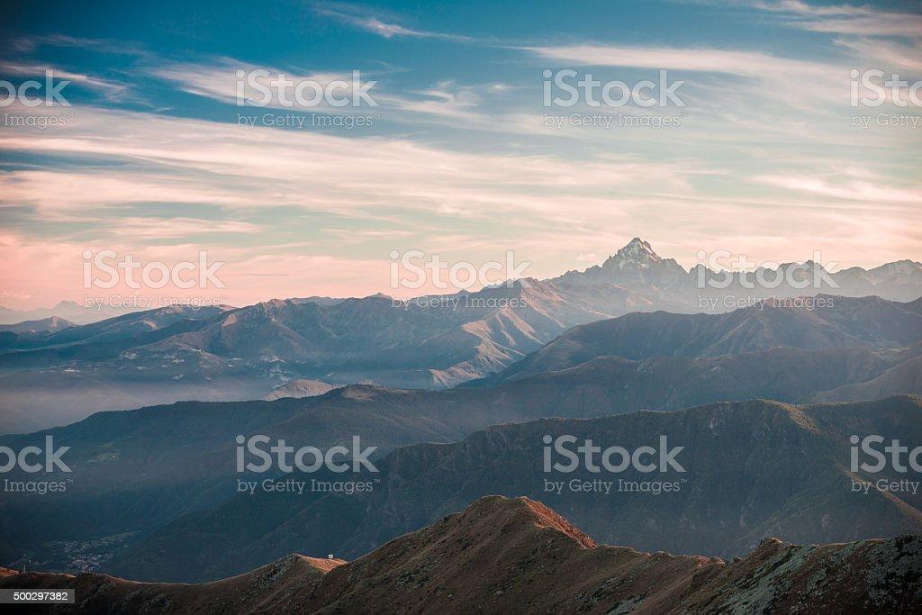 Sunset on majestic mountain peak, vintage film effect stock photo