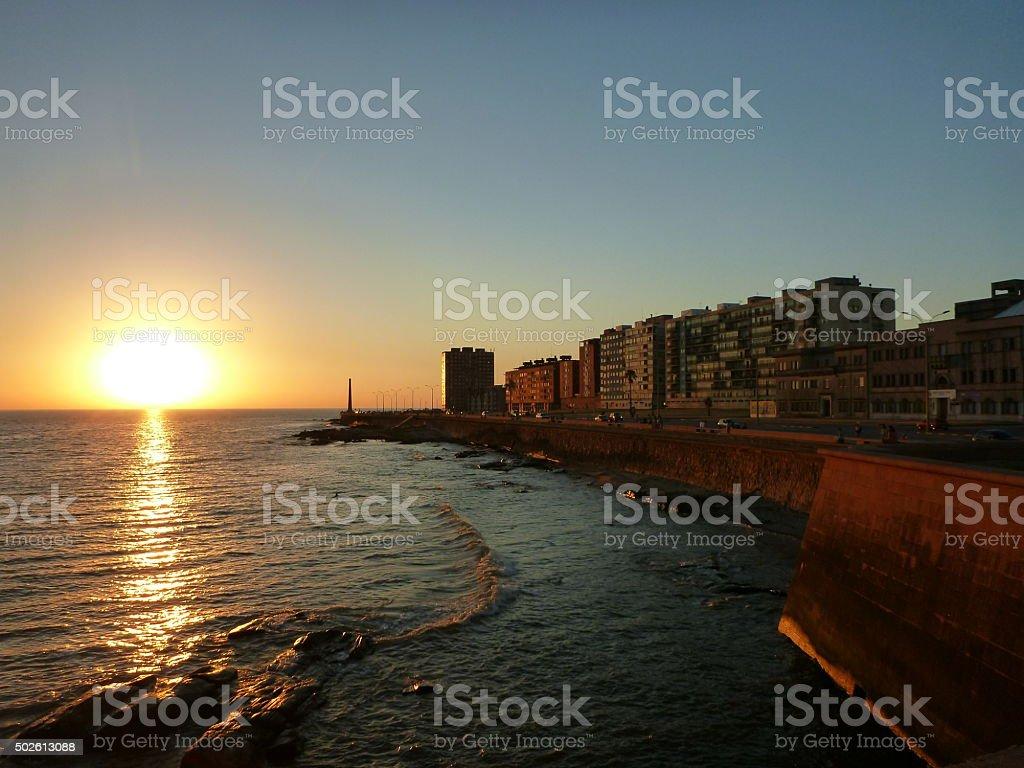 Sunset on Montevideo waterfront promenade Ramblas, Uruguay stock photo