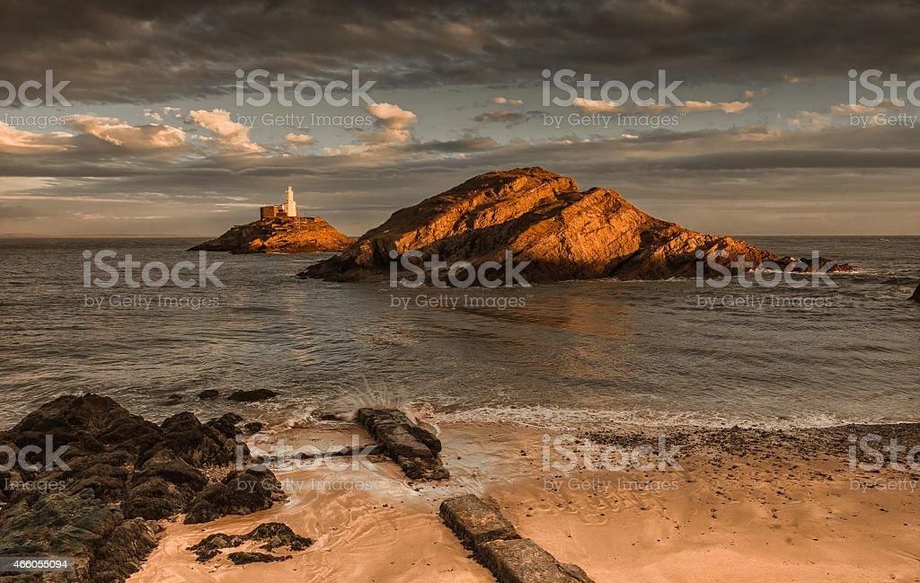 Sunset on Mumbles lighthouse Swansea stock photo