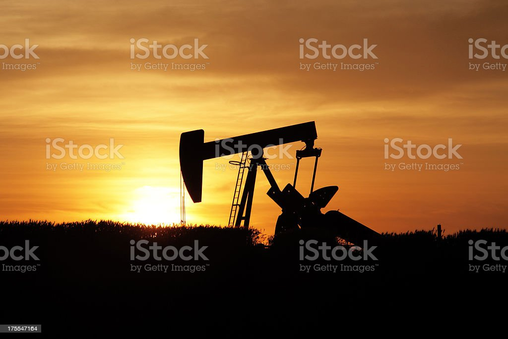 Sunset on oil derrick royalty-free stock photo