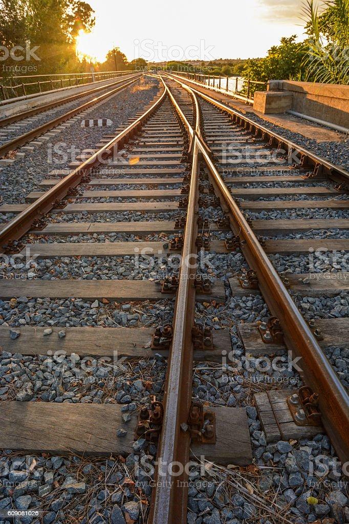 sunset on railroad stock photo