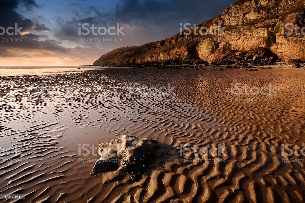 Sunset on Rocky Coastline and Beach with Tide Going Out royalty-free stock photo