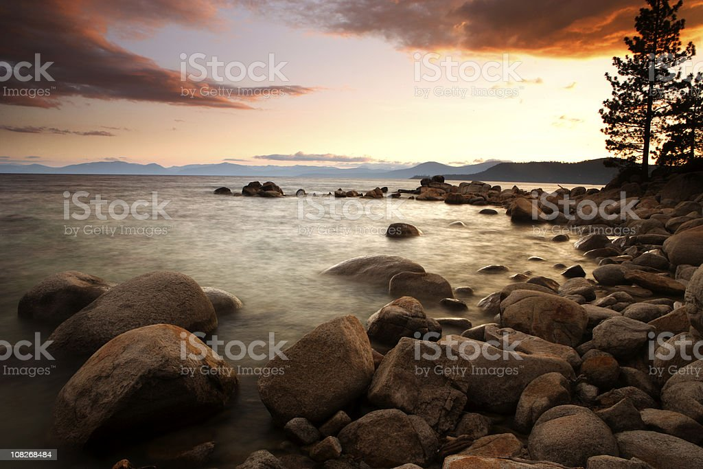 Sunset on Rocky Lake Tahoe Shore stock photo