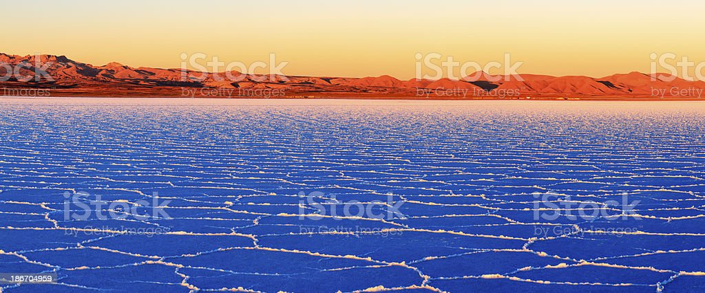 Sunset on Salar de Uyuni, Altiplano Bolivia royalty-free stock photo