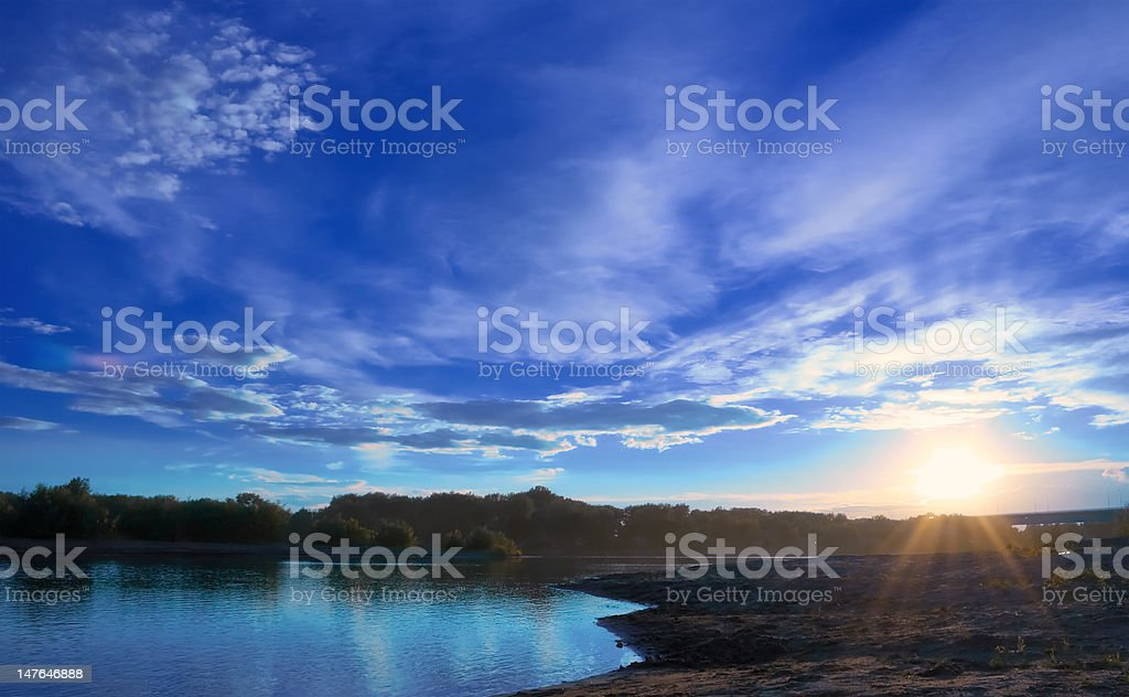 Sunset on the bank of river royalty-free stock photo