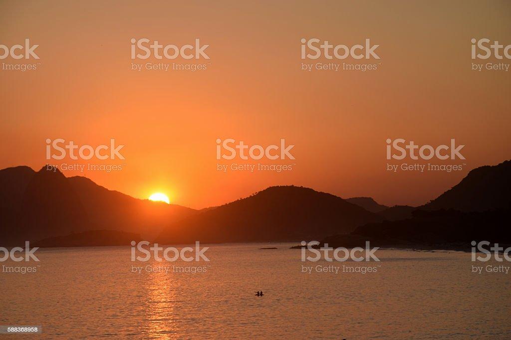 Sunset on the beach in Rio de Janeiro stock photo