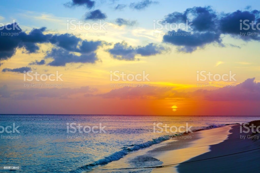 Sunset on the beach of caribbean sea stock photo