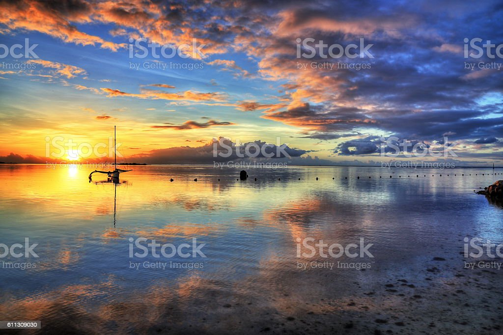 Sunset on the beach of Moorea, French Polynesia stock photo