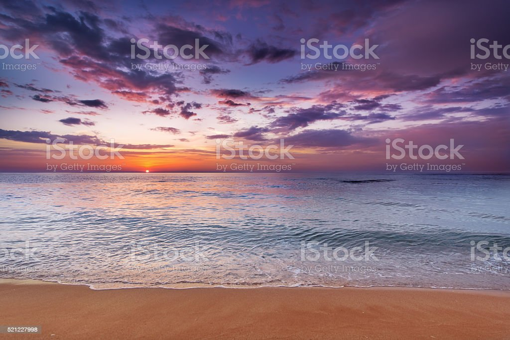 Sunset on the beach with beautiful sky. stock photo