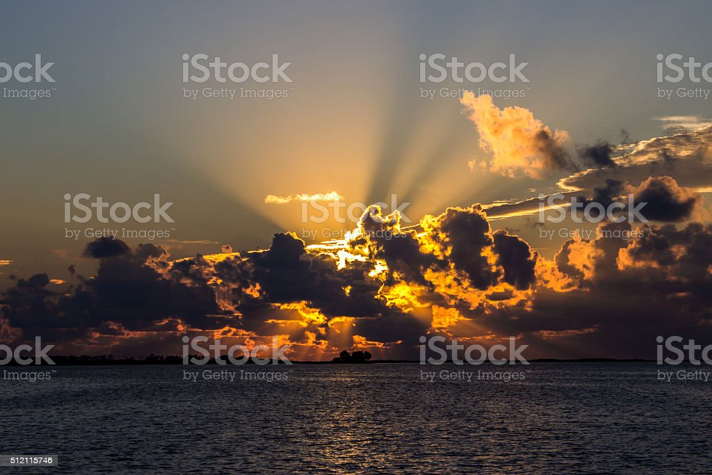 Sunset on the Beach with Clouds stock photo