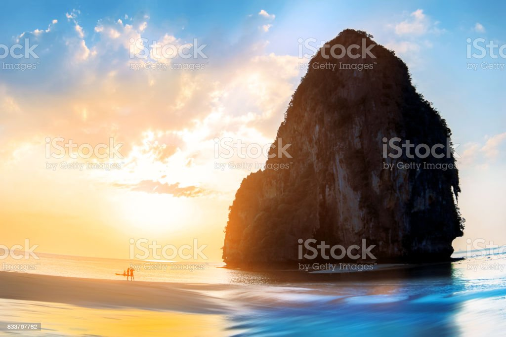 Sunset on the beautiful beach in the province of Krabi. Railay Beach. Thailand. Blue and yellow colors image. stock photo