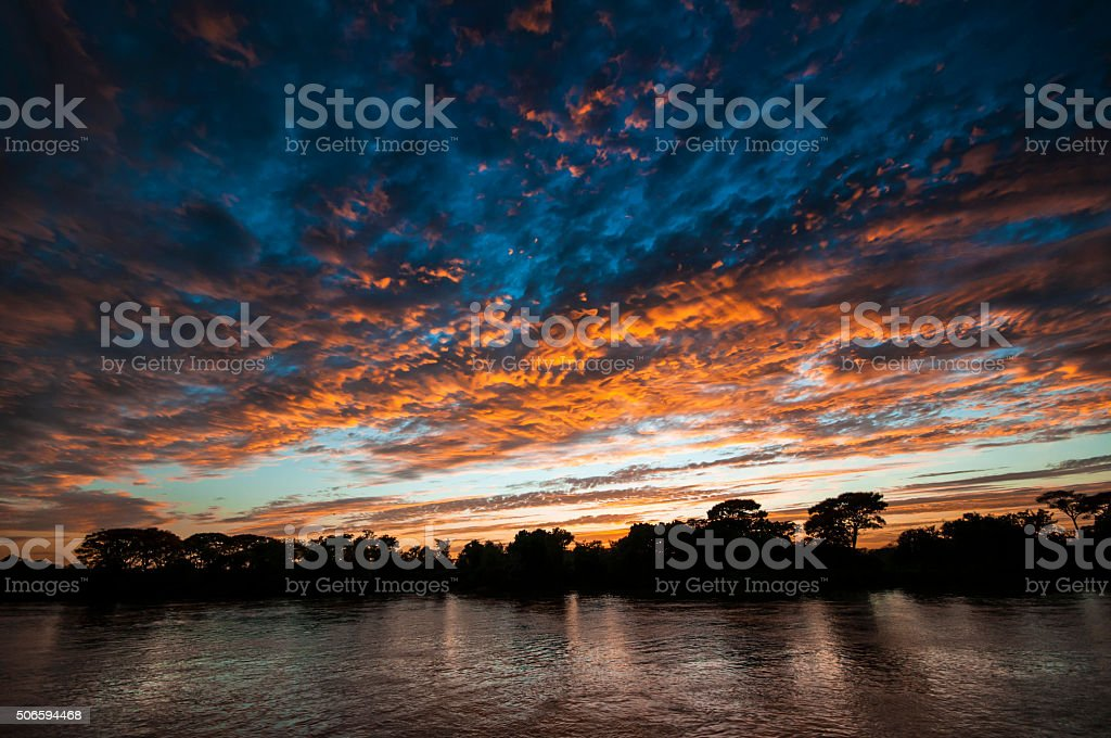 sunset on the Cuiaba river in the Pantanal in Brazil stock photo