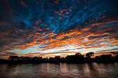 sunset on the Cuiaba river in the Pantanal in Brazil