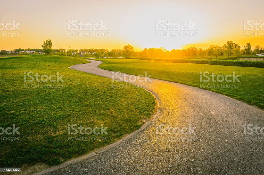 Sunset on the golf course road stock photo