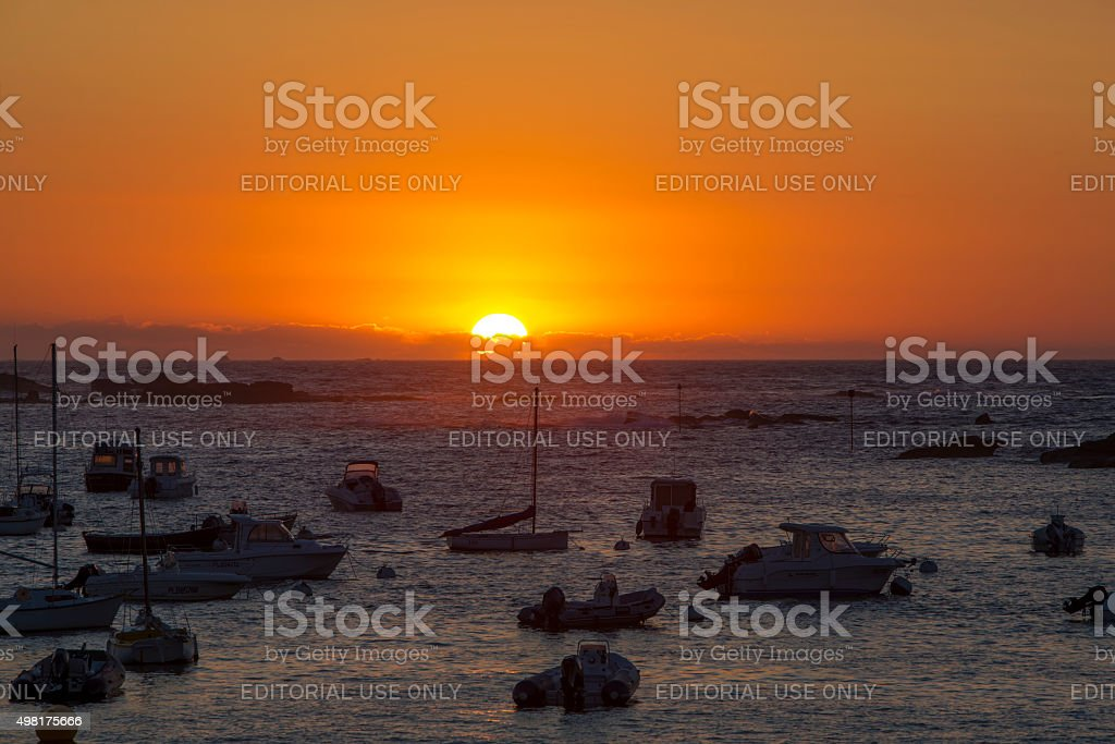 Sunset on the harbour of Tregastel stock photo