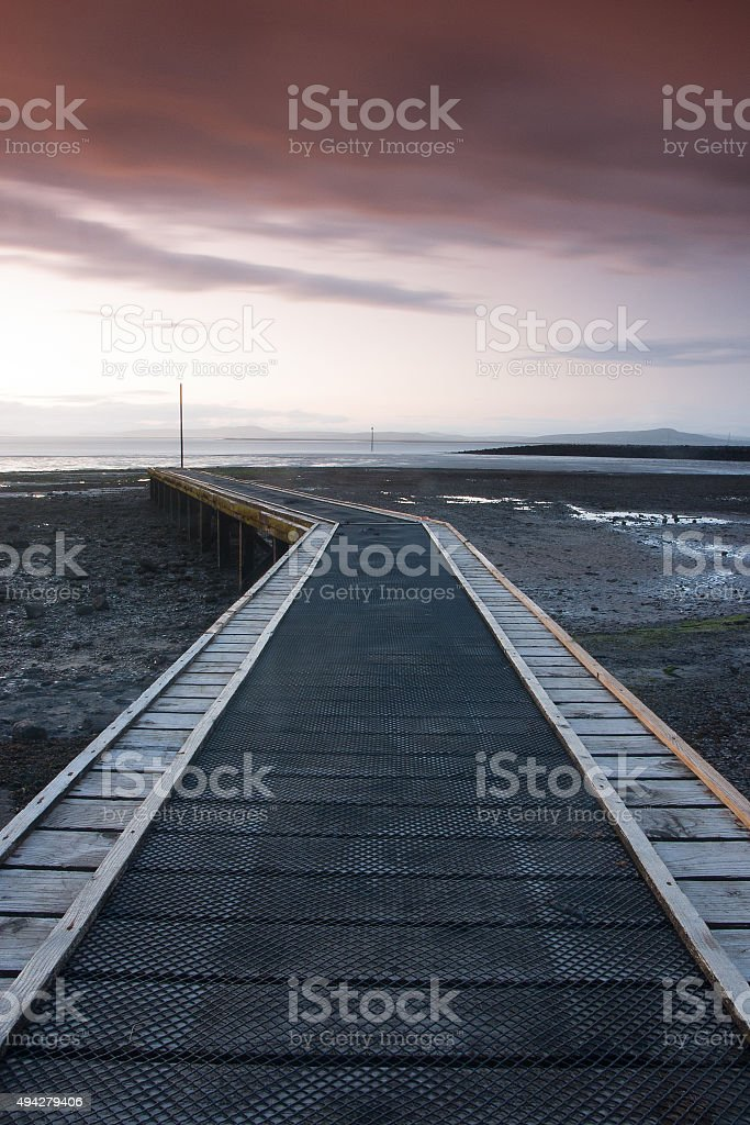 Sunset on the jetty in Morecambe Bay stock photo
