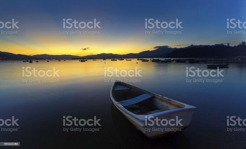 sunset on the lake, boat royalty-free stock photo