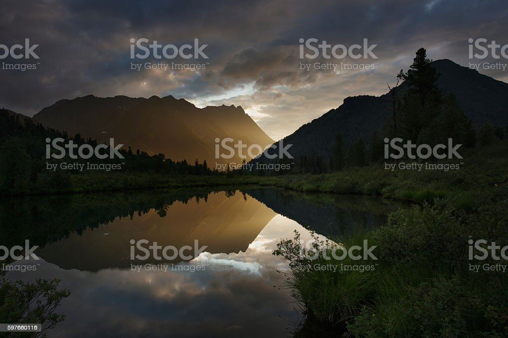 Sunset on the lake in mountains of the Eastern Sayan stock photo