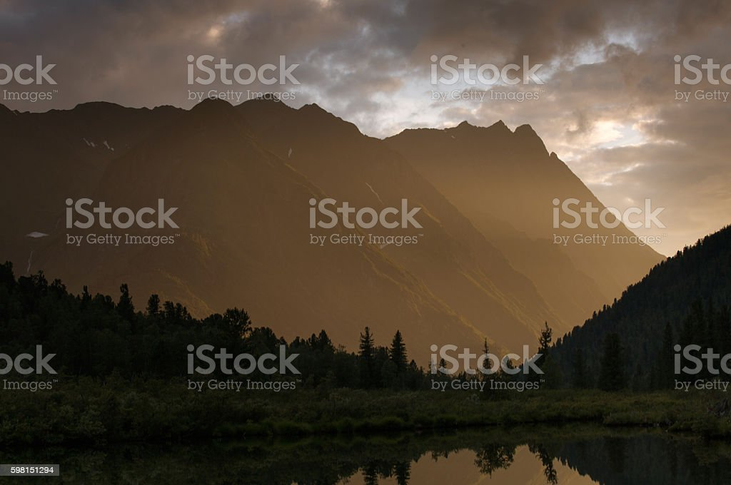 Sunset on the lake in mountains of the Eastern Sayan royalty-free stock photo