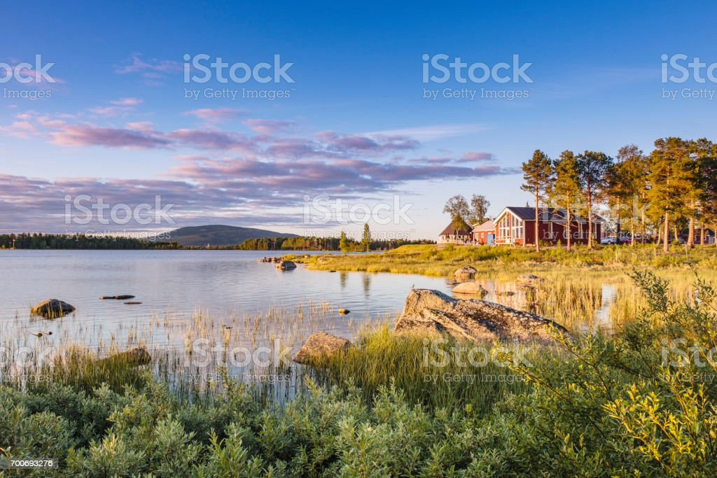 Sunset on the lake in Northern Sweden. stock photo