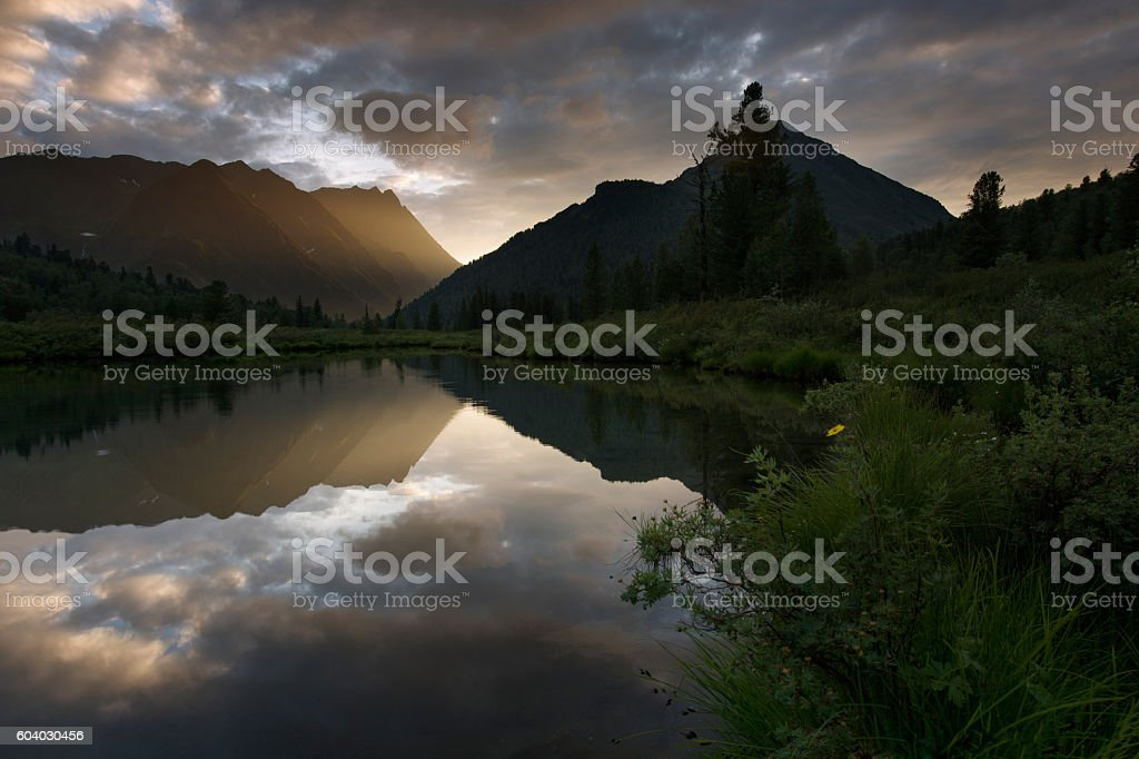 Sunset on the lake in the mountains Eastern Sayan royalty-free stock photo