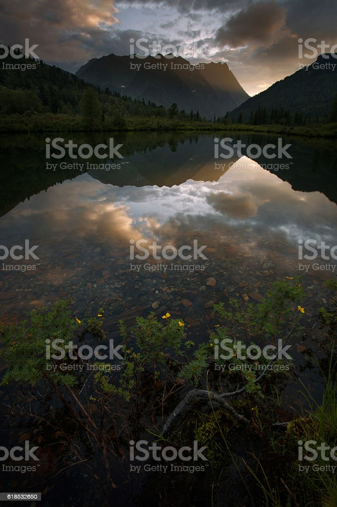Sunset on the lake in the mountains of Eastern Sayan stock photo