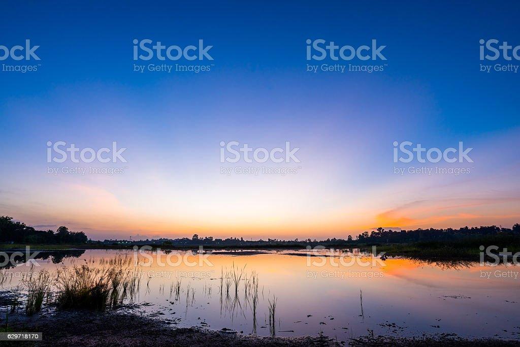 sunset on the lake landscape stock photo