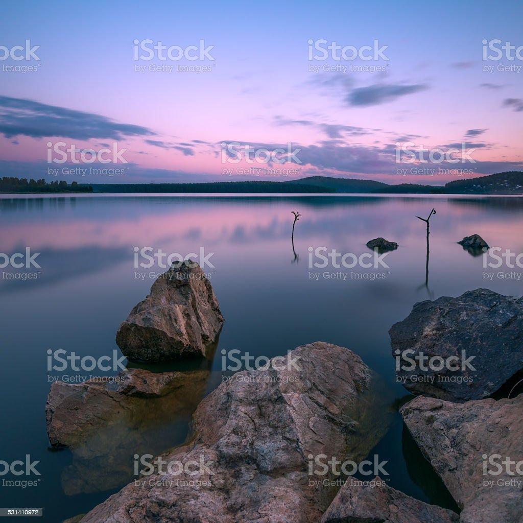 Sunset on the lake. Long exposure stock photo