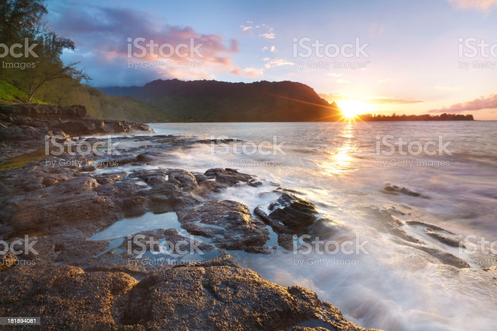 sunset on the north shore of kauai, hawaii stock photo