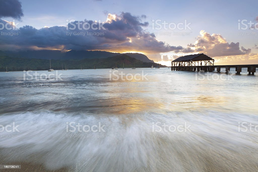 sunset on the pier of hanalei, kauai, hawaii royalty-free stock photo