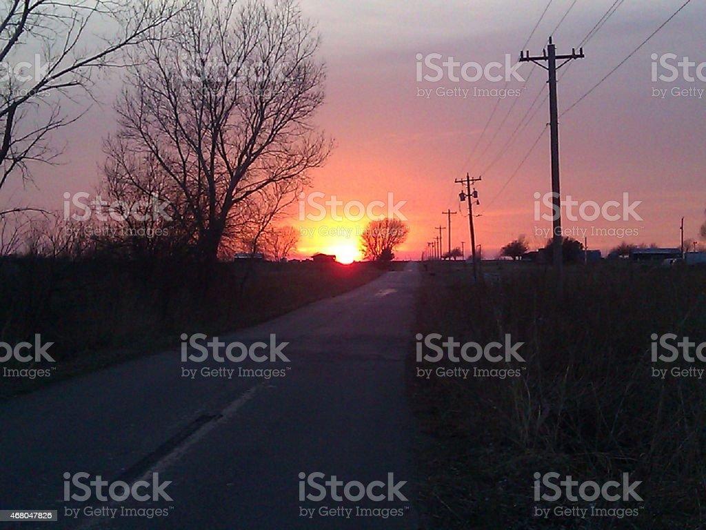 Coucher de soleil sur la route photo libre de droits