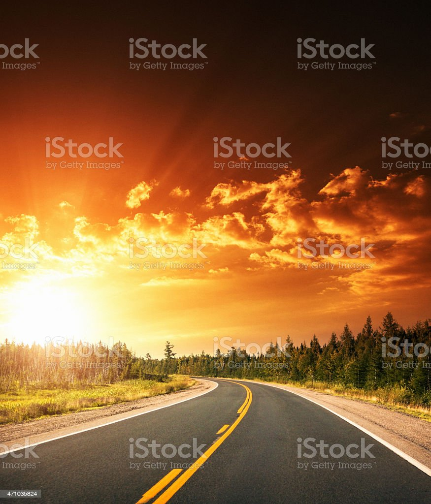 Sunset on the road stock photo