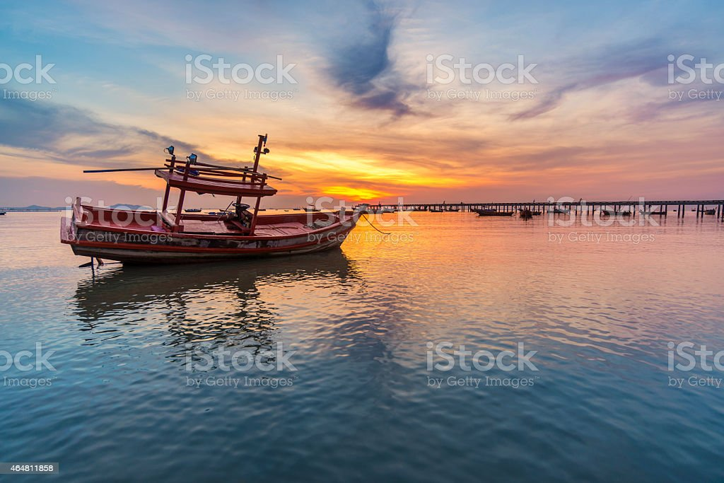 sunset on the sea and the boat stock photo