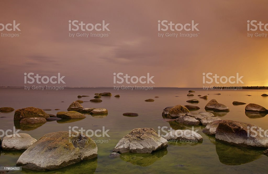 Sunset on the sea shore royalty-free stock photo