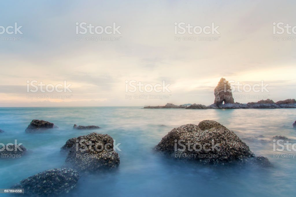 Sunset on the sea. Slow shutter speed. Fishing boats. Beautiful sunset on the sea. Stones on the sea. Amazing seascape. Background. Hunting for squid in Thailand. Seascape with long exposure. stock photo