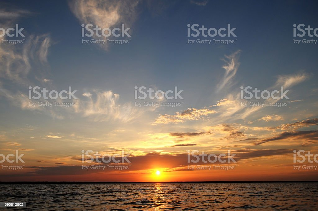 sunset on the sea with clouds stock photo